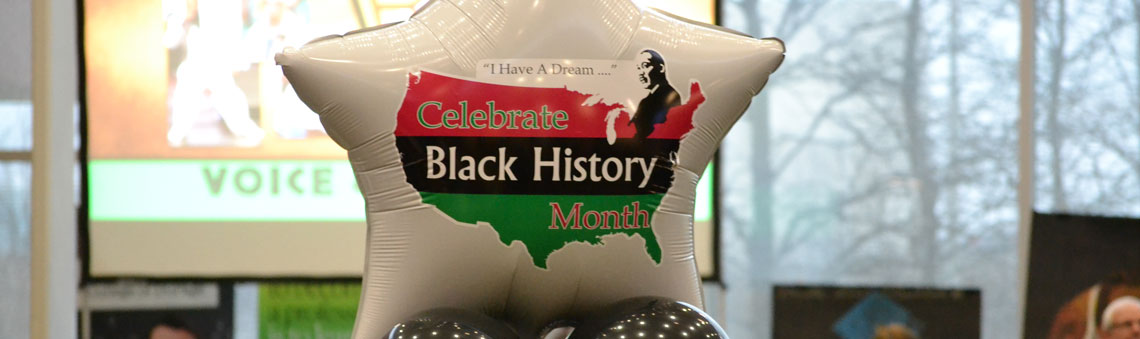Star balloon setup at Black History Month event