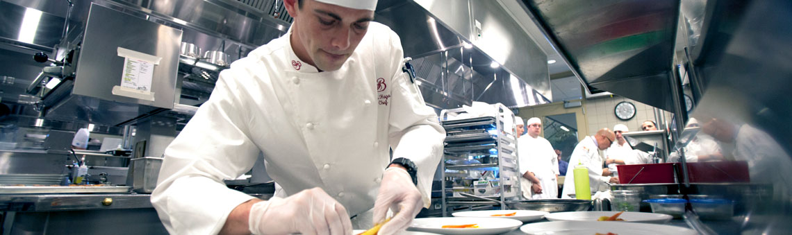 culinary chef at work in commercial kitchen
