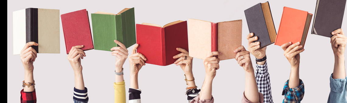 Hands holding up books