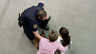 police officer assisting two women