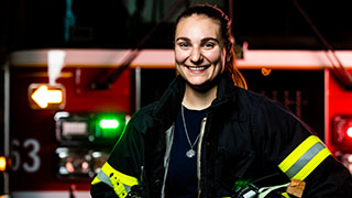 female firefighter graduate