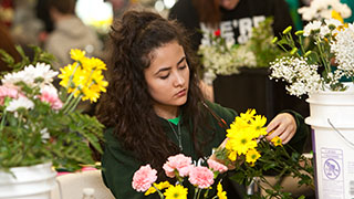 student working on a floral competition