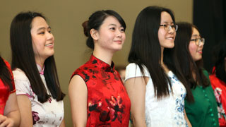 Chinese students standing for fashion show