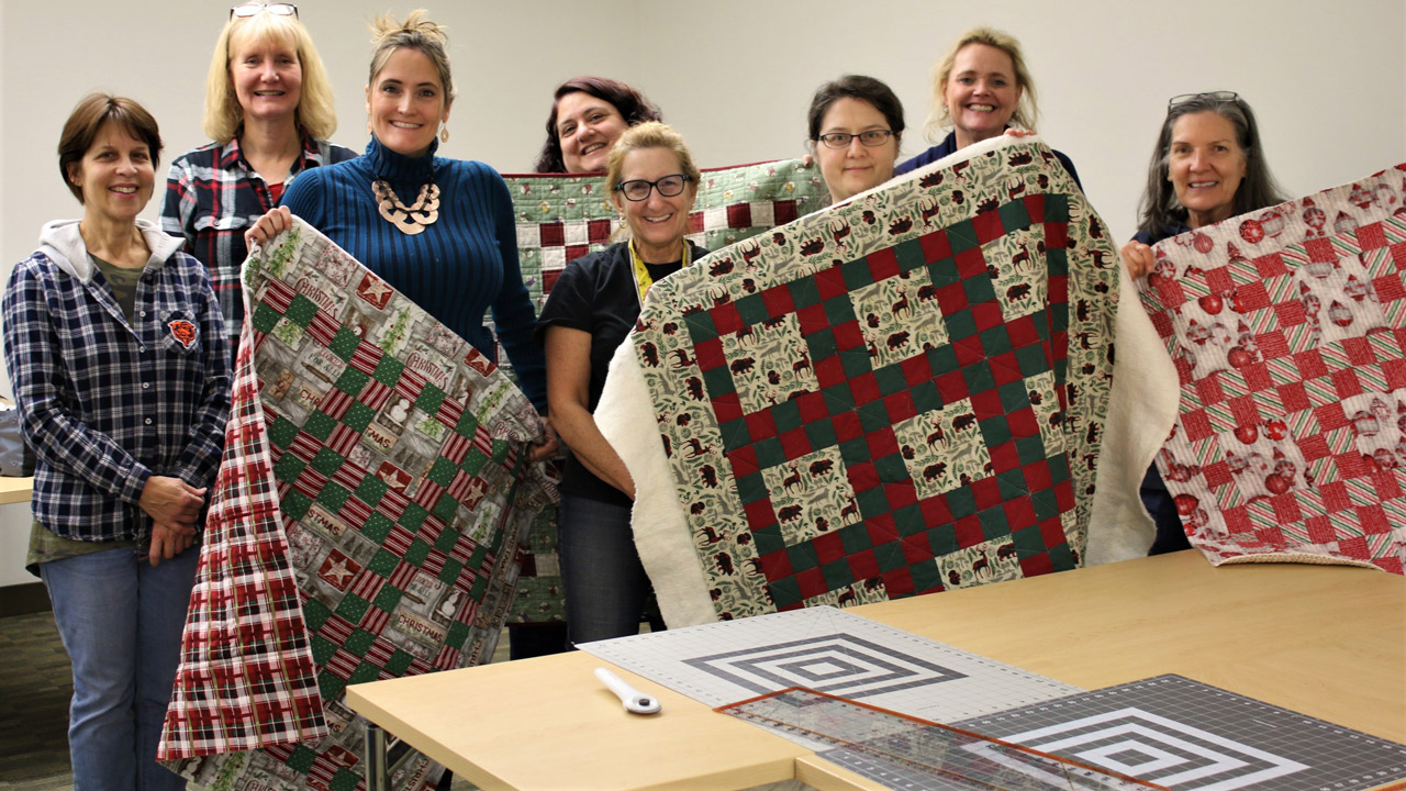 Adults with quilts
