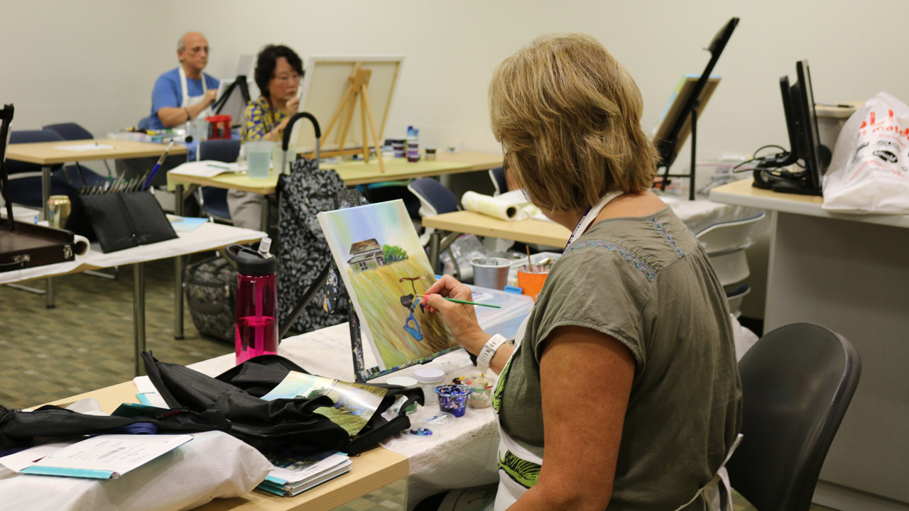 Instructor leads watercolor painting class