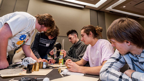 Students building something at a table