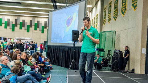 Teacher speaks to audience at STEMCON