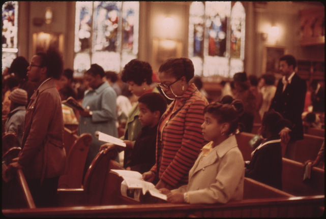 Worshippers at holy angel catholic church on chicago's south side. It is the city's largest black catholic church. The pastor is father George H. Clements, a leader in the black community. (Public Domain)