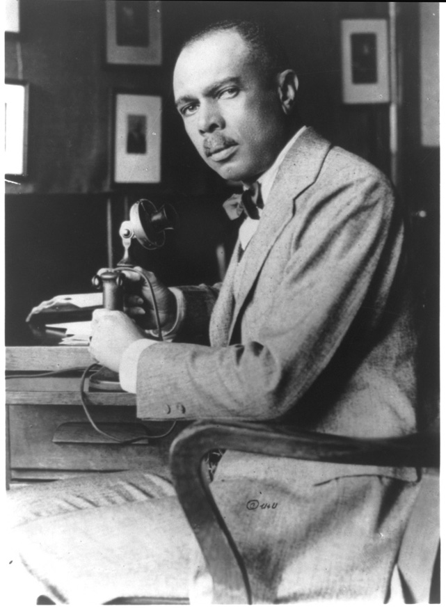 James Weldon Johnson. The Autobiography of an Ex-Colored Man James Weldon Johnson, half-length portrait at desk with telephone (Public Domain)