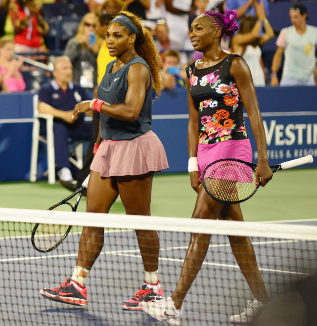Serena and Venus Williams during their first round of doubles in the 2013 US Open. (Creative Commons)