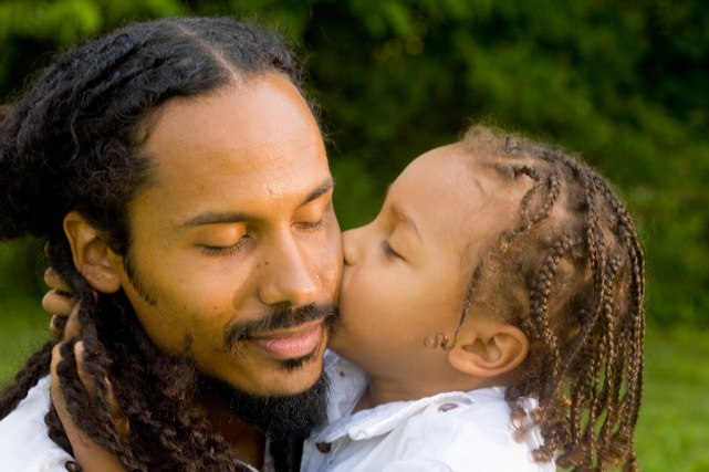 African American man holding his daughter photo