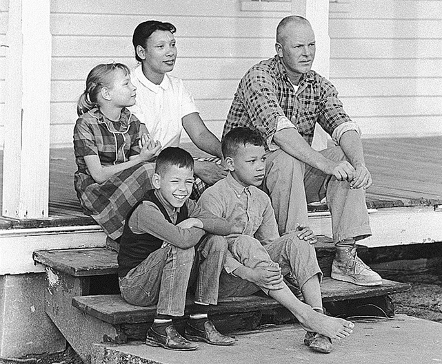 Photo of family sitting on a porch